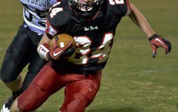 DeKalb's Mr. Football Signs Scholarship