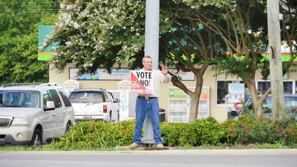 """Citizen Wes McBride, pastor at Central Baptist Church, helps get the """"No"""" message out on Monday before polls open. (Photo by Tyler Pruett)"""