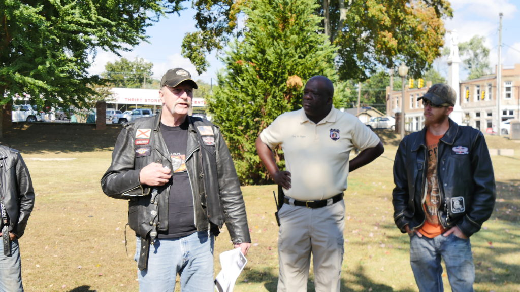 Johnny Vaughn, President of Bikers Urban Response Needed, addresses the volunteers, along with Fort Payne Police Chief Randy Bynum. (Tyler Pruett | Southern Torch)
