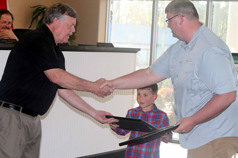 4 year old receives proclamation for helping elderly woman
