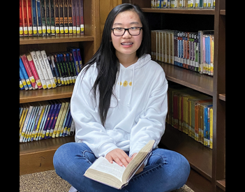 Shi Excels in School Reading